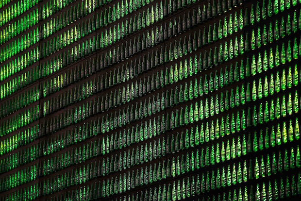 AMSTERDAM, NETHERLANDS - DECEMBER 07: A detailed view of the Heineken Light Installation at Heineken Experience on December 7, 2012 in Amsterdam, Netherlands. Heineken marks its 140-year anniversary by inviting people to be part of the celebration in a major light installation on the wall of its spiritual home, brought to life through social media. Created from 5,000 iconic Heineken bottles the LED-lit exhibit will stand tall outside the Heineken Experience in the centre of Amsterdam, December 7th 2012- January 3rd 2013 as one of the Amsterdam Light Festival's highlights. As part of an open global party people are invited to share their own celebration messages through Facebook which will light up in a dynamic animated showcase, alongside bold images inspired by the brand's iconic history. (Photo by Dean Mouhtaropoulos/Getty Images for Heineken)