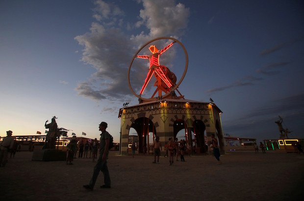 The Man is illuminated as approximately 70,000 people from all over the world gather for the 30th annual Burning Man arts and music festival in the Black Rock Desert of Nevada, U.S. August 31, 2016. REUTERS/Jim Urquhart FOR USE WITH BURNING MAN RELATED REPORTING ONLY. FOR EDITORIAL USE ONLY. NOT FOR SALE FOR MARKETING OR ADVERTISING CAMPAIGNS. NO THIRD PARTY SALES. NOT FOR USE BY REUTERS THIRD PARTY DISTRIBUTORS - RTX2NR8O
